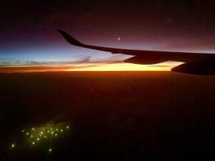 Zonsondergang vanuit het vliegtuig