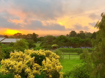 Zonsondergang vanuit de huiskamer van Anne
