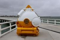 Duikersklok op de pier van Port Welshpool